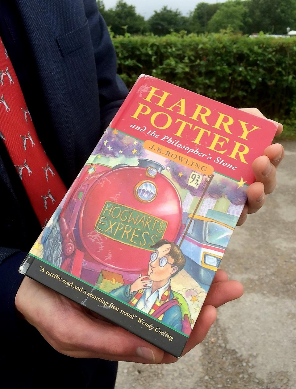 Hansons Auctioneers' Jim Spencer with the Harry Potter first edition. (Source: Hansons Auctioneers)
