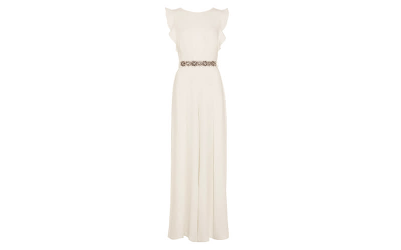 """<p>The hunt for a chic jumpsuit is over, as Phase Eight's sell-out Victoriana number is a serious contender. With a vintage-inspired belt, romantic ruffle shoulders and delicate pleats – it's a must for summer brides. <a rel=""""nofollow noopener"""" href=""""https://www.phase-eight.com/fcp/product/phase-eight/wedding-dresses/victoriana-bridal-jumpsuit/206292106"""" target=""""_blank"""" data-ylk=""""slk:Shop now"""" class=""""link rapid-noclick-resp""""><em>Shop now</em></a>. </p>"""