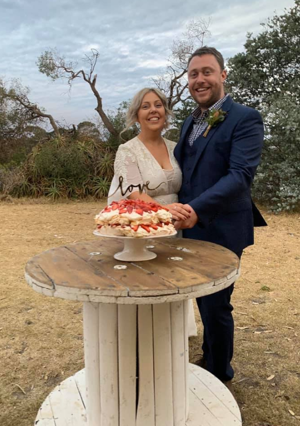 The overjoyed couple pose with their wedding cake at Paynesville. Source: Adele Charlwood