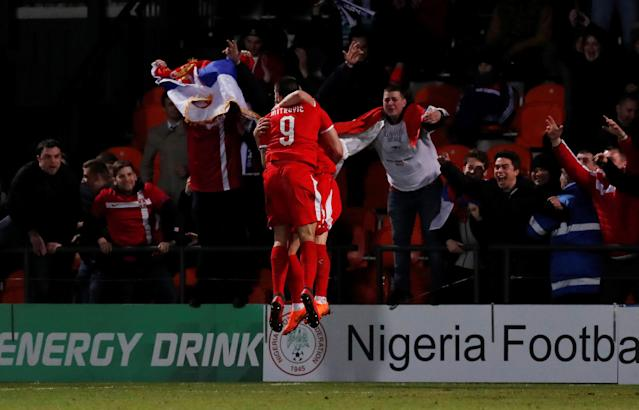 Soccer Football - International Friendly - Nigeria vs Serbia - The Hive Stadium, London, Britain - March 27, 2018 Serbia's Aleksandar Mitrovic celebrates scoring their second goal with team mates Action Images via Reuters/Peter Cziborra