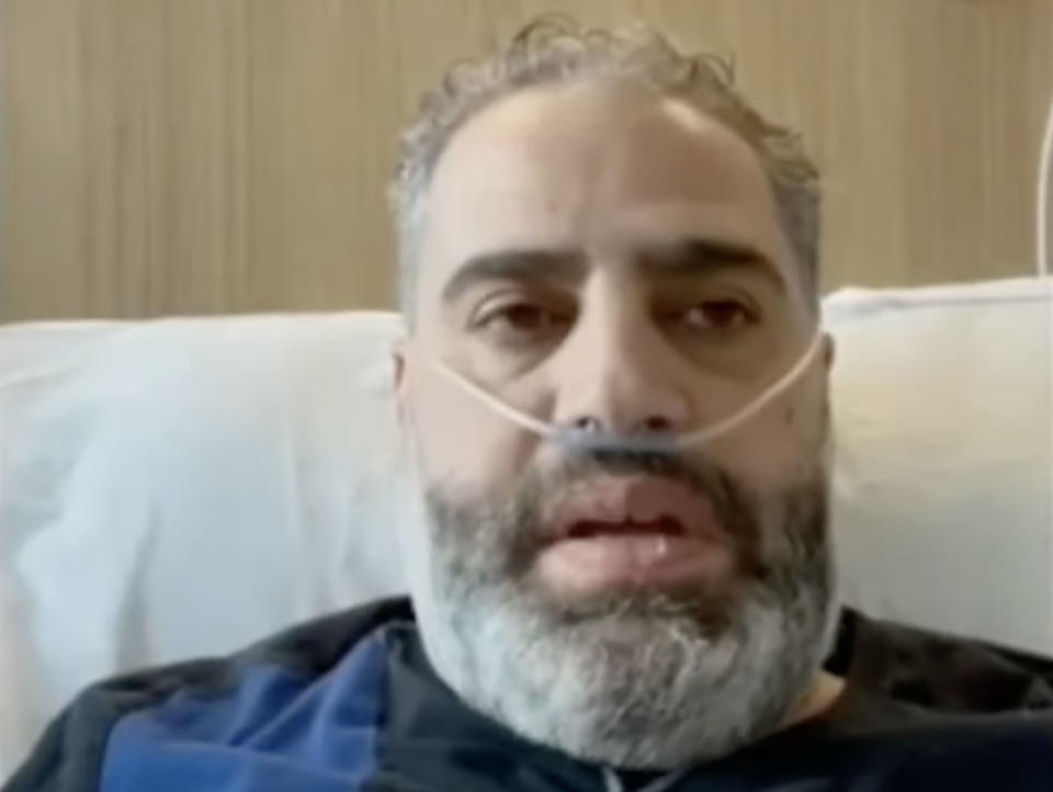 Khaled Elmasri, 47, is pictured in a hospital bed.