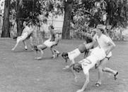 <p>Members of the English soccer team participating in the World Cup compete in a wheel barrel race during practice. We assume they were goofing around here, but who knows!</p>