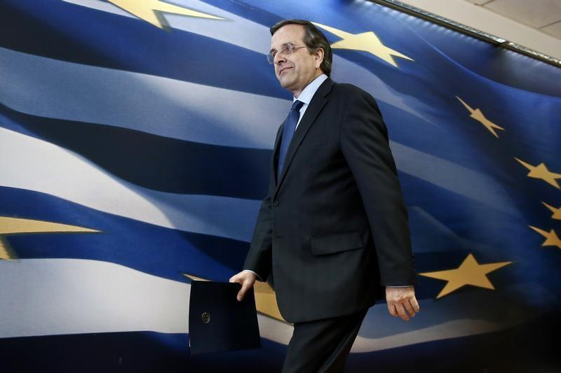 Greece's PM Samaras arrives to address reporters at a news briefing in Athens