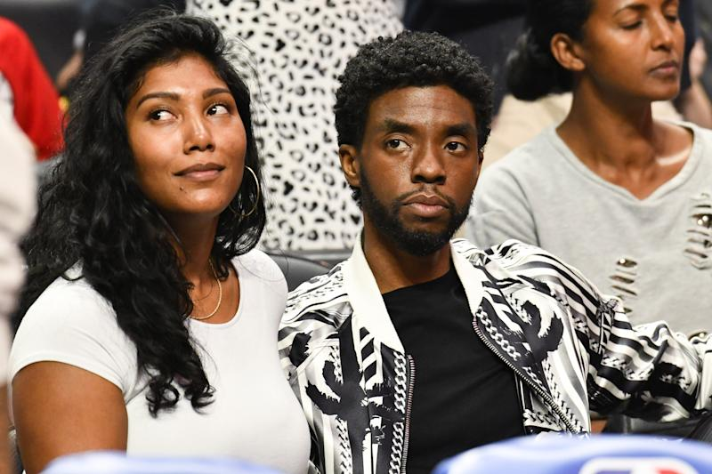 LOS ANGELES, CALIFORNIA - OCTOBER 22: Taylor Simone Ledward and Chadwick Boseman attend a basketball game between the Los Angeles Clippers and the Los Angeles Lakers at Staples Center on October 22, 2019 in Los Angeles, California. (Photo by Allen Berezovsky/Getty Images)