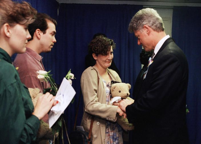 FILE - In this Sunday, April 23, 1995 file photo, Aren Almon of Oklahoma City, clutches a teddy bear as she is greeted by President Bill Clinton in Oklahoma City, Okla., after a prayer service for the victims of Wednesday's deadly car bomb attack in downtown Oklahoma City. Almon's 1-year old daughter, Baylee, was killed in the attack. (AP Photo/Pat Sullivan)