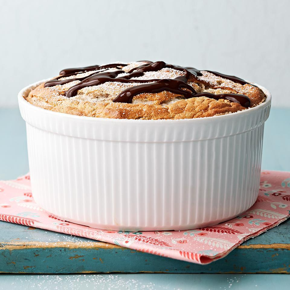 <p>This delicious dessert is topped with chocolate syrup and powdered sugar.</p>