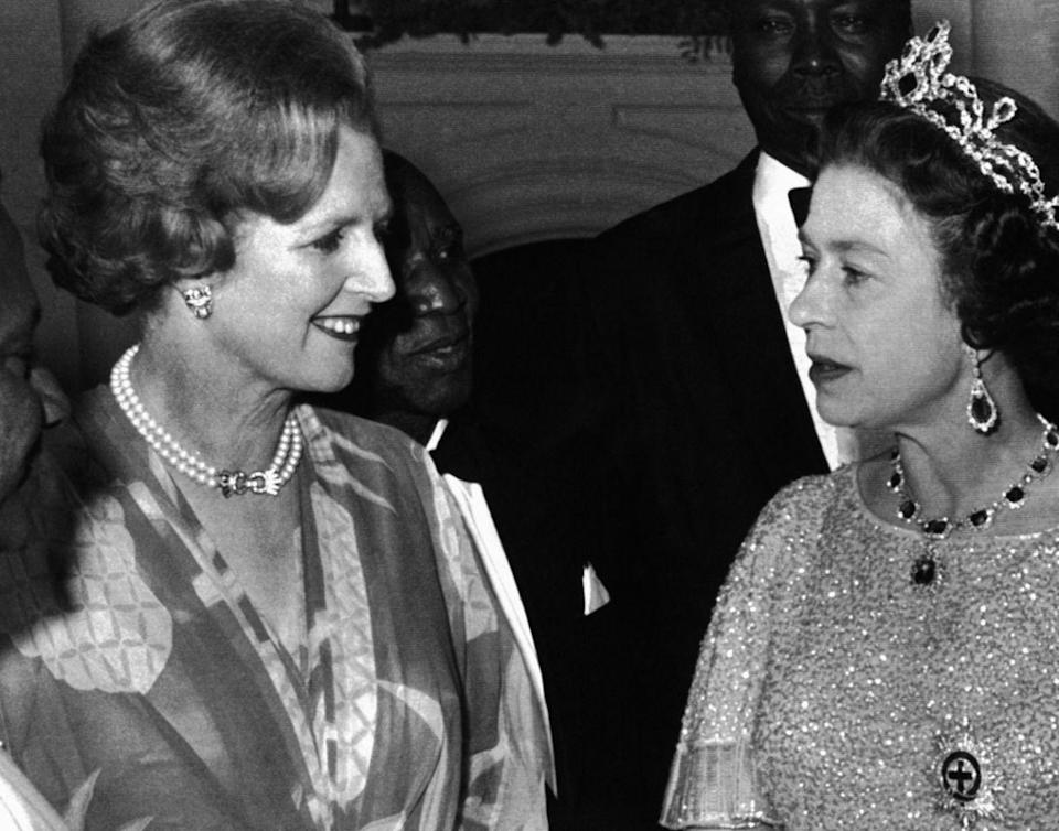 <p>Queen Elizabeth II has a conversation with Prime Minister, Margaret Thatcher, at a reception for the 39 heads of delegations attending the Commonwealth Conference in Lusaka, Zambia. (AP Photo) </p>