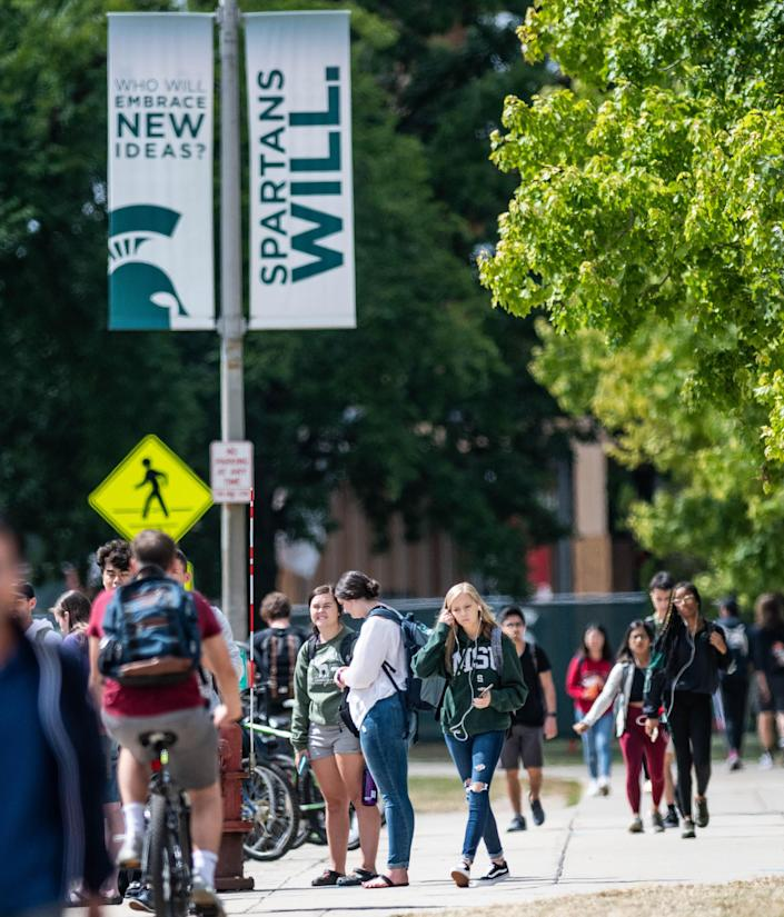 Students commute on the campus of Michigan State University Thursday, Sept. 5, 2019, near the International Center.