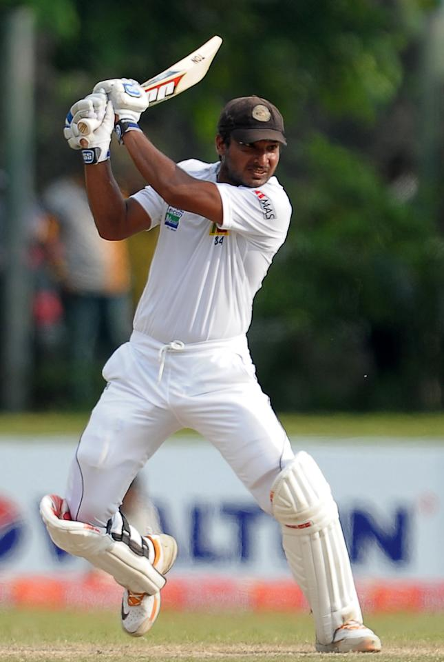 Sri Lankan batsman Kumar Sangakkara plays a shot during the fourth day of the opening Test match between Sri Lanka and Bangladesh at the Galle International Cricket Stadium in Galle on March 11, 2013. Bangladesh were bowled out for 638 in their first innings in reply to Sri Lanka's 570-4 declared on the fourth day of the opening Test in Galle on Monday. AFP PHOTO/ LAKRUWAN WANNIARACHCHI        (Photo credit should read LAKRUWAN WANNIARACHCHI/AFP/Getty Images)