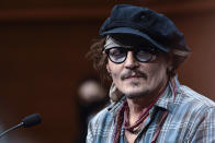 US actor Johny Deep after a photocall at the 69th San Sebastian Film Festival, in San Sebastian, northern Spain, Wednesday, Sept. 22, 2021. Johny Depp will be receiving on the night Donostia Award for his contribution to the cinema. (AP Photo/Alvaro Barrientos)