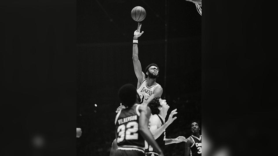 Mandatory Credit: Photo by Lennox Mclendon/AP/Shutterstock (6600513a)Kareem Abdul-Jabbar, Lew Alcindor Los Angeles Lakers Kareem Abdul-Jabbar (33) shoots one of his patented sky-hooks in Los Angeles during first quarter action against the Denver Nuggets in Los Angeles, .