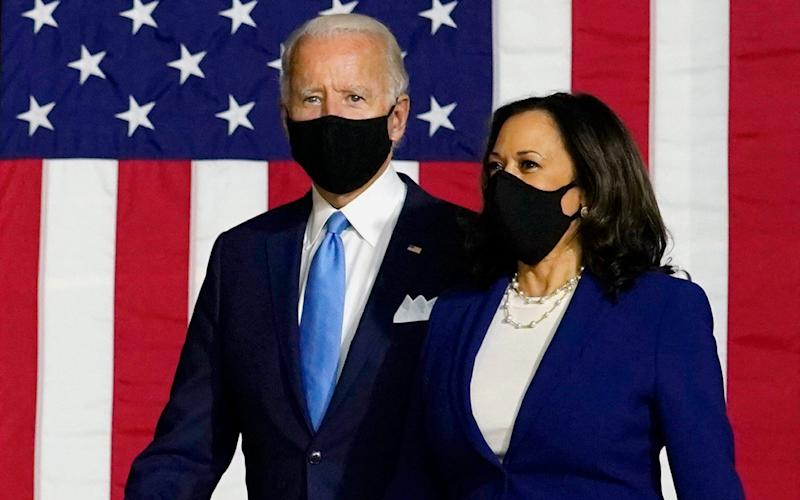 Democratic presidential candidate former Vice President Joe Biden and his running mate Sen. Kamala Harris, D-Calif., arrive to speak at a news conference at Alexis Dupont High School in Wilmington, Del., Wednesday, Aug. 12, 2020 - Carolyn Kaster/AP