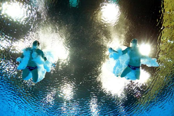 LONDON, ENGLAND - AUGUST 01:  Troy Dumais and Kristian Ipsen of the United States compete in the Men's Synchronised 3m Springboard final on Day 5 of the London 2012 Olympic Games at the Aquatics Centre on August 1, 2012 in London, England.  (Photo by Clive Rose/Getty Images)