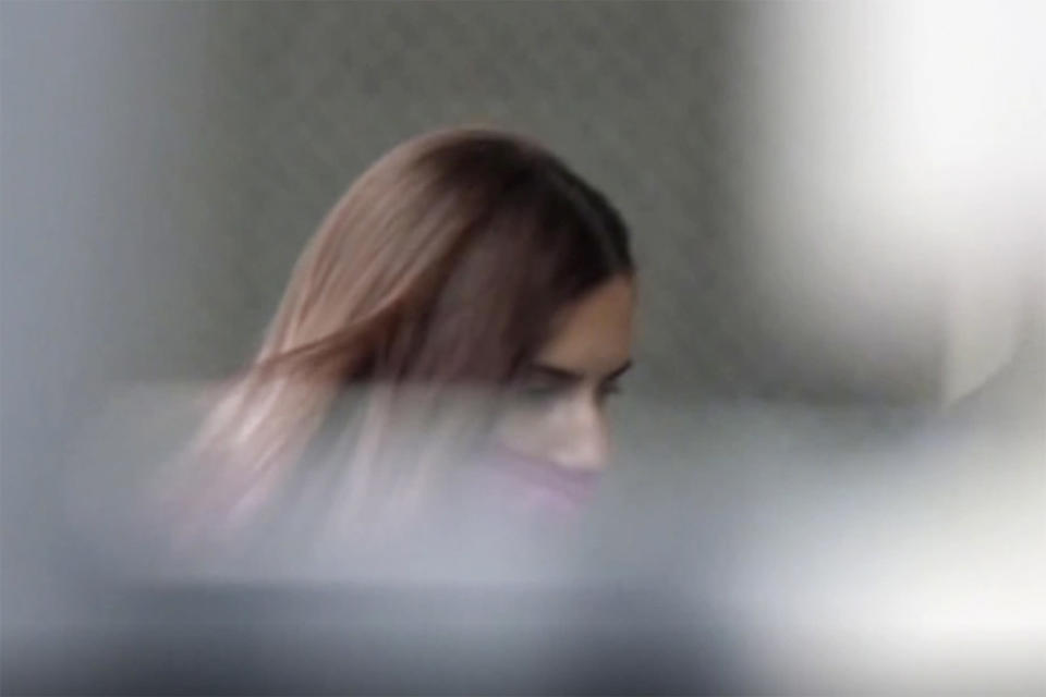 In this image made from video provided by NTV, Belarus Olympic sprinter Krystsina Tsimanouskaya enters the Polish embassy in Tokyo, Japan, Monday, Aug. 2, 2021. Tsimanouskaya plans to seek asylum in Poland, an activist group said Monday, after the athlete alleged that her team's officials tried to force her to fly home, where she feared she wouldn't be safe from an autocratic government that recently was accused of diverting a plane in order to arrest a dissident journalist. (NTV via AP)