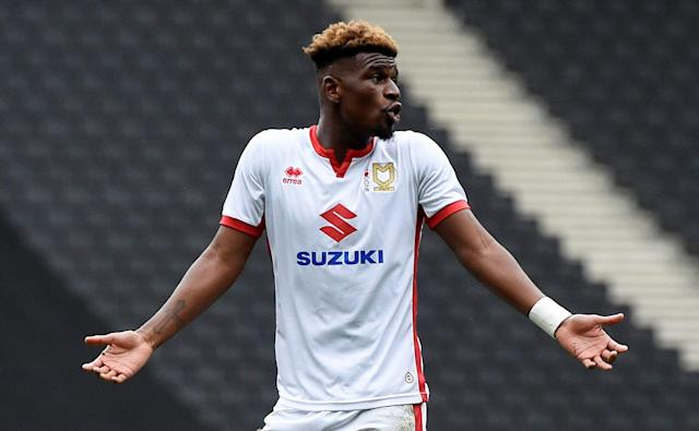 "Soccer Football - League One - Milton Keynes Dons vs Bradford City - Stadium MK, Milton Keynes, Britain - October 7, 2017 MK Dons' Aaron Tshibola protests after being sent off Action Images/Alan Walter EDITORIAL USE ONLY. No use with unauthorized audio, video, data, fixture lists, club/league logos or ""live"" services. Online in-match use limited to 75 images, no video emulation. No use in betting, games or single club/league/player publications. Please contact your account representative for further details."