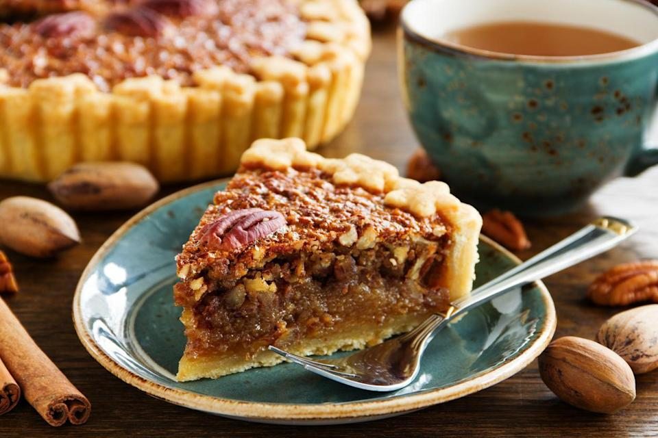 """<p>Pecan pie is an icon of Texas and one of <a href=""""https://www.thedailymeal.com/most-iconic-pie-every-state-gallery?referrer=yahoo&category=beauty_food&include_utm=1&utm_medium=referral&utm_source=yahoo&utm_campaign=feed"""" rel=""""nofollow noopener"""" target=""""_blank"""" data-ylk=""""slk:the most famous pies in America"""" class=""""link rapid-noclick-resp"""">the most famous pies in America</a>. This recipe is made up of sweet fillings and topped with roasted pecans but also adds some chocolate.</p> <p><a href=""""https://www.thedailymeal.com/recipes/decadent-chocolate-pecan-pie-recipe-0?referrer=yahoo&category=beauty_food&include_utm=1&utm_medium=referral&utm_source=yahoo&utm_campaign=feed"""" rel=""""nofollow noopener"""" target=""""_blank"""" data-ylk=""""slk:For the Pecan Pie recipe, click here."""" class=""""link rapid-noclick-resp"""">For the Pecan Pie recipe, click here.</a></p>"""