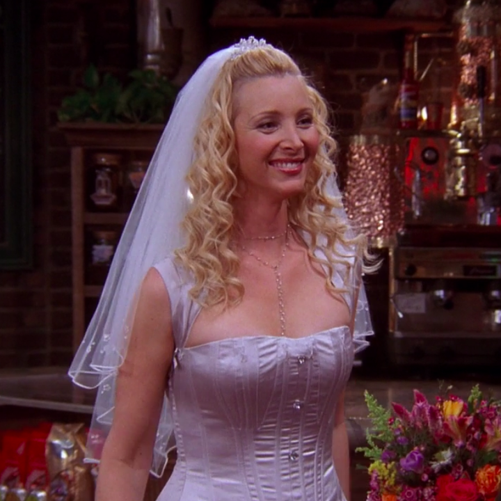 Phoebe wearing what seems like a silk gown with a structured bodice