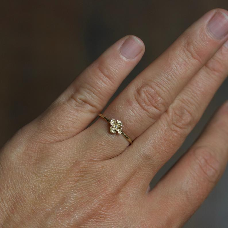 """<h3>Mary John Hydrangea Blossom Ring<br></h3> <br>We swooned over the affordable selection of organic, handmade fine jewelry in Mary John's Etsy shop, but ultimately landed on this solid gold hydrangea ring — a design that the North Carolina-based designer carved herself from wax. So sweet!<br><br><em>Shop Mary John on <strong><a href=""""https://www.etsy.com/shop/MARYJOHN"""" rel=""""nofollow noopener"""" target=""""_blank"""" data-ylk=""""slk:Etsy"""" class=""""link rapid-noclick-resp"""">Etsy</a></strong></em><br><br><strong>Mary John</strong> Hydrangea Blossom Flower Ring, $, available at <a href=""""https://go.skimresources.com/?id=30283X879131&url=https%3A%2F%2Fwww.etsy.com%2Flisting%2F662731190%2Frose-gold-flower-ring-hydrangea-blossom"""" rel=""""nofollow noopener"""" target=""""_blank"""" data-ylk=""""slk:Etsy"""" class=""""link rapid-noclick-resp"""">Etsy</a><br><br><br>"""