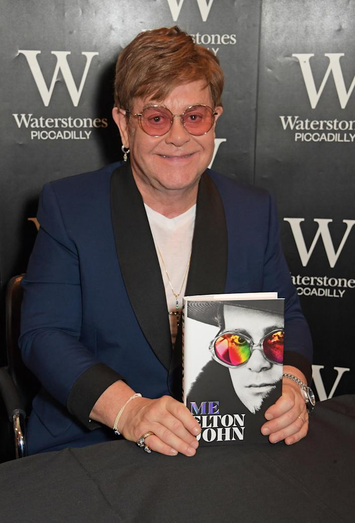 """Sir Elton John signs copies of his autobiography """"Me"""" for fans at Waterstones Piccadilly on November 20, 2019 in London, England. (Photo by David M. Benett/Dave Benett/Getty Images for Macmillan)"""