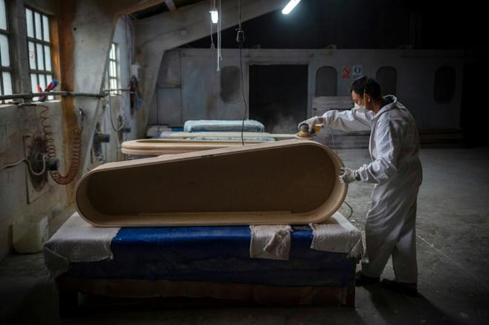 Demand has doubled for burial caskets from the remote village of Pinor in northwest Spain (AFP Photo/MIGUEL RIOPA)