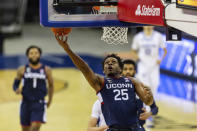 Connecticut forward Josh Carlton (25) drives to the basket for a layup against Creighton in the first half during an NCAA college basketball game Saturday, Jan. 23, 2021, in Omaha, Neb. (AP Photo/John Peterson)