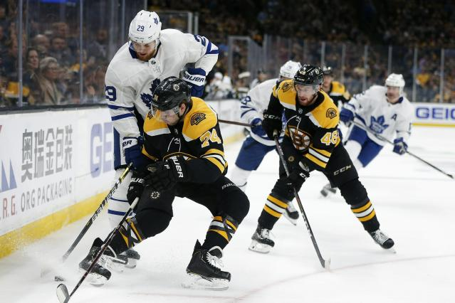 Toronto Maple Leafs' William Nylander (29) and Boston Bruins' Jake DeBrusk (74) compete for the puck during the first period in Game 5 of an NHL hockey first-round playoff series in Boston, Friday, April 19, 2019. (AP Photo/Michael Dwyer)