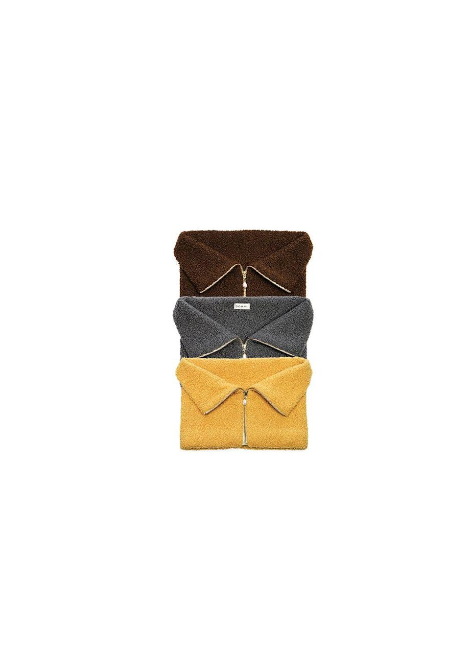 """<p>What do you get when a dickey meets a scarf? These cool neck cuffs that can be worn with outerwear or to warm up a sweatshirt or sweater. </p><p><em>Donni</em>, $108 each</p><p><a class=""""link rapid-noclick-resp"""" href=""""https://shopdonni.com/products/copy-of-mini-sherpa-zip-cuff-camel"""" rel=""""nofollow noopener"""" target=""""_blank"""" data-ylk=""""slk:SHOP NOW"""">SHOP NOW</a></p>"""
