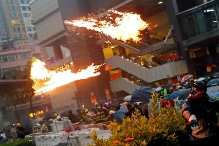 FILE PHOTO: An anti-extradition bill protester throws a Molotov cocktail as protesters clash with riot police during a rally to demand democracy and political reforms, at Tsuen Wan, in Hong Kong