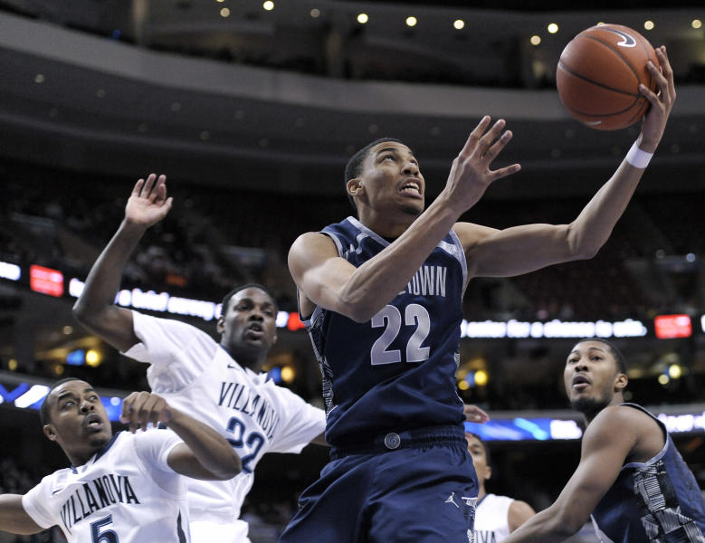 Georgetown's Otto Porter Jr. (22) drives past Villanova's Tony Chennault (5) and JayVaughn Pinkston (22) during the first half of an NCAA college basketball game, Wednesday, March 6, 2013, in Philadelphia. (AP Photo/Michael Perez)