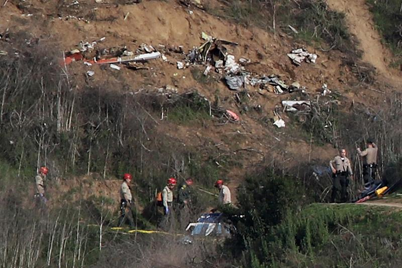 Sherriffs and officials investigate the helicopter crash site of NBA star Kobe Bryant (REUTERS)