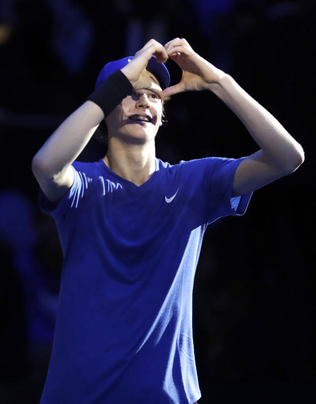 Jannik Sinner of Italy, celebrates after winning the ATP Next Gen tennis tournament semifinal match against Miomir Kecmanovic of Serbia,in Milan, Italy, Friday, Nov. 8, 2019. (AP Photo/Luca Bruno)