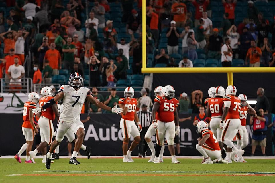 Virginia Cavaliers linebacker Noah Taylor celebrates after Miami Hurricanes place kicker Andres Borregales misses the potential game-winning field goal at Hard Rock Stadium.