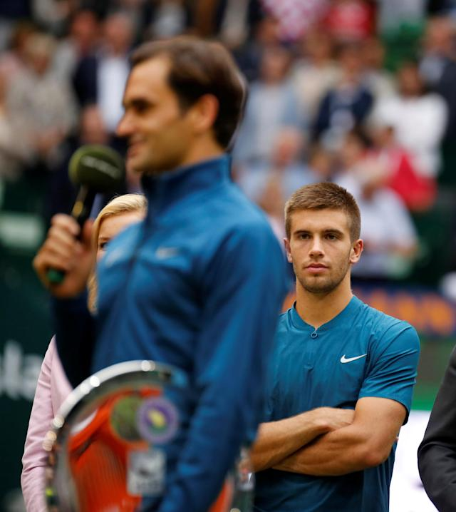 Tennis - ATP - Halle Open Finals - Gerry Weber Stadion, Halle, Germany - June 24, 2018 Croatia's Borna Coric watches on after winning the final as Switzerland's runner up Roger Federer speaks to the crowd REUTERS/Leon Kuegeler