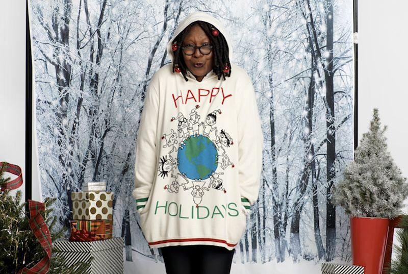 Whoopi Goldberg modeling one of her holiday sweaters.