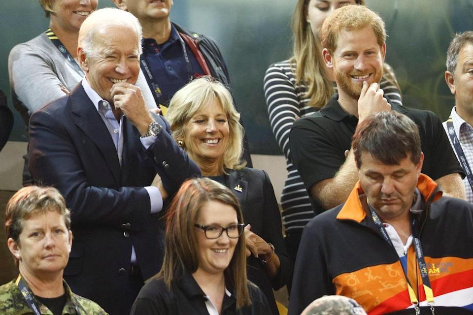 Britain's Prince Harry, former Vice President of the U.S. Joe Biden (L) and his wife Jill Biden (C) watch the U.S. play the Netherlands at the wheelchair gold medal basketball event during the Invictus Games in Toronto, Ontario, Canada September 30, 2017