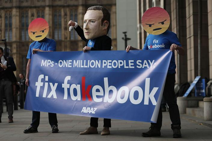 Protestors from the pressure group Avaaz demonstrate outside Portcullis house where Facebook's Chief Technology Officer Mike Schroepfer is to be questioned by members of parliament in London on April 26, 2018. (Photo by Daniel LEAL-OLIVAS / AFP) (Photo credit should read DANIEL LEAL-OLIVAS/AFP/Getty Images)