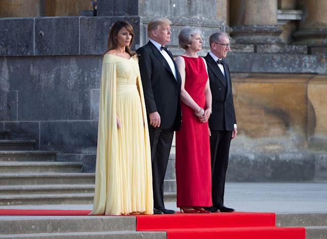 <p>For a dinner with Theresa May at Blenhiem Palace, Melania turned heads in a stunning lemon yellow J.Mendel gown costing £5000. <br><em>[Photo: Rex]</em> </p>