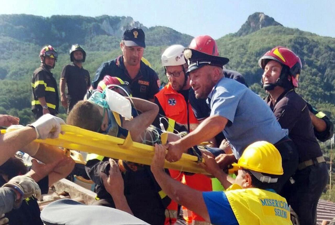 <p>Firefighters and rescuers pull out a boy, Mattias, from the collapsed building in Casamicciola, on the island of Ischia, near Naples, Italy, a day after a 4.0-magnitude quake hit the Italian resort island, Tuesday, Aug. 22, 2017. (Photo: Italian Carabinieri, HO/ANSA via AP) </p>