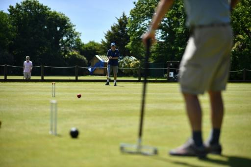Players in action at Sussex County Croquet Club on the south coast of England