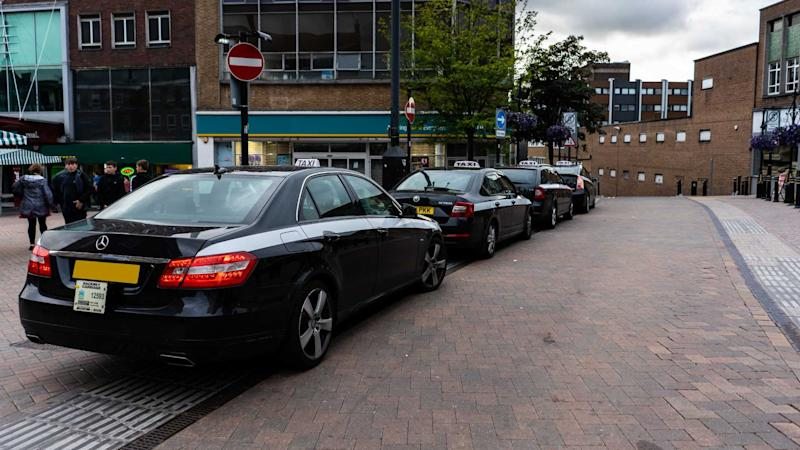 Taxis wait for customers in Newcastle Under Lyme Staffordshire