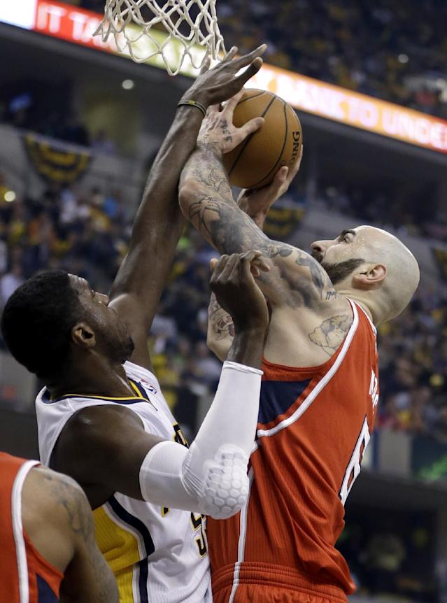 Atlanta Hawks' Pero Antic (6) has his shot blocked by Indiana Pacers' Roy Hibbert, left, during the first half in Game 5 of an opening-round NBA basketball playoff series Monday, April 28, 2014, in Indianapolis. (AP Photo/Darron Cummings)