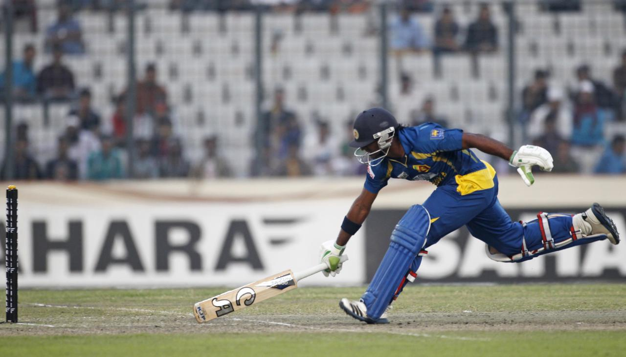Sri Lanka's Kusal Perera runs to avoid a run out against Bangladesh during their third one day international (ODI) cricket match of the series in Dhaka February 22, 2014. REUTERS/Andrew Biraj (BANGLADESH - Tags: SPORT CRICKET)