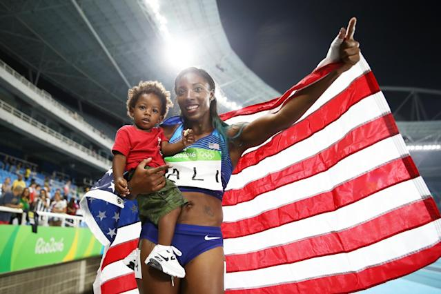 Nia Ali of the United States celebrates with her son Titus after winning the silver medal in the Women's 100m Hurdles at the Rio 2016 Olympic Games. (Getty)