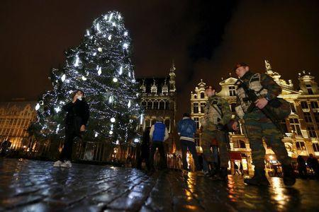 Belgian soldiers patrol Brussels' Grand Place on November 22, 2015, after security was tightened in Belgium following the fatal attacks in Paris. REUTERS/Yves Herman