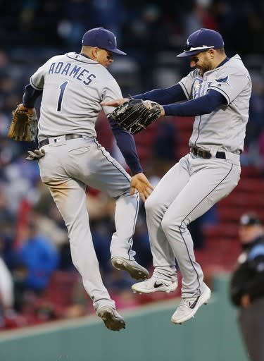 Tampa Bay Rays' Willy Adames (1) and Kevin Kiermaier celebrate after defeating the Boston Red Sox in a baseball game in Boston, Saturday, April 27, 2019. (AP Photo/Michael Dwyer)