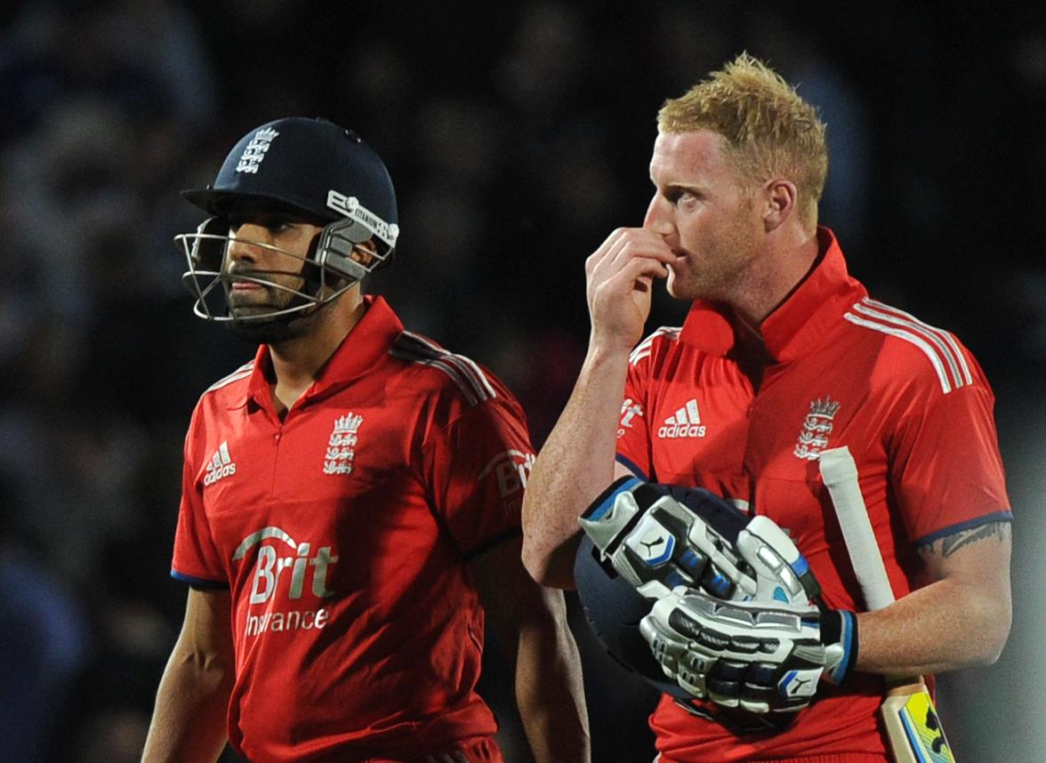 England's Ravi Bopara and Ben Stokes react as they leave the field after losing the Natwest International Twenty20 match at the Kia Oval, London.