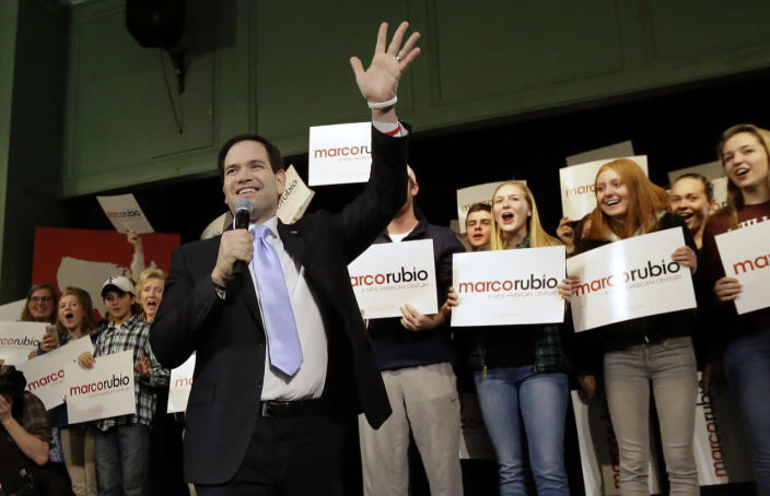 <p>Rubio waves as he takes the stage during a campaign event, Tuesday, Feb. 2, 2016, in Exeter. <i>(Photo: Steven Senne/AP)</i></p>