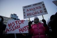 People attend a peace vigil to mourn the victims of anti-Asian hate crimes in New York