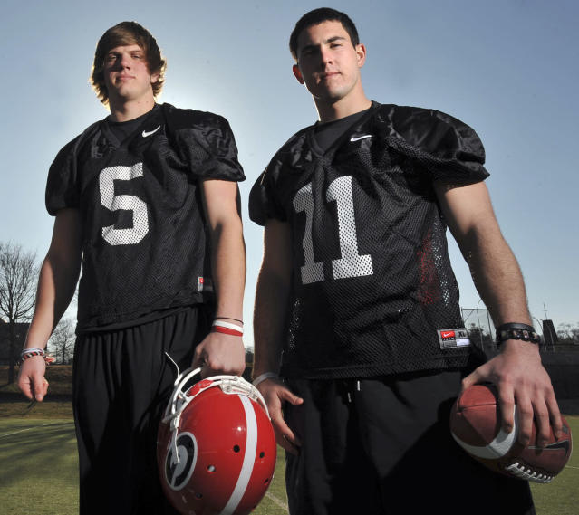 FILE - In this Feb. 26, 2010, file photo, Georgia quarterbacks Zach Mettenberger (5) and Aaron Murray (11) pose for a photo in Athens, Ga. Murray won the job, guided Georgia back to national prominence, and became the most prolific passer in school history. Mettenberger ran into legal troubles, was forced out of Athens, and landed as the starter for Southeastern Conference rival LSU. On Saturday, these former teammates will go against each other for the first time when Georgia hosts LSU. (AP Photo/Atlanta Journal Constitution, Brant Sanderlin, File)