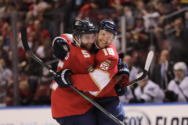 Florida Panthers' Mike Matheson (19) celebrates with teammate Aaron Ekblad (5) after scoring a goal during the second period of an NHL hockey game against the San Jose Sharks, Sunday, Dec. 8, 2019, in Sunrise, Fla. (AP Photo/Luis M. Alvarez)